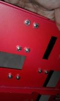 pemasangan velcro dengan mur dan baut